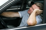 Man asleep at the wheel