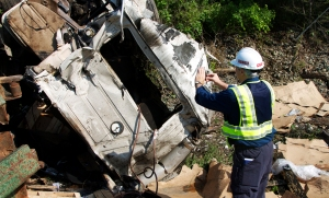 Investigator Ted Turpin documenting damage at the scene of the rail grade crossing collision in White Marsh, Md.