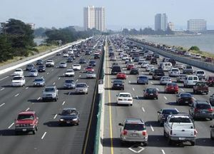 Interstate 80, seen here in Berkeley, California, is a freeway with many lanes and heavy traffic. Photo: Wikipedia