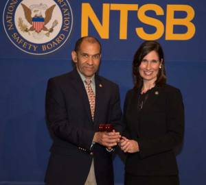 Outgoing Chairman Hersman presents the gavel to Vice Chairman Hart