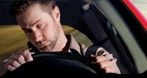 A man asleep while driving
