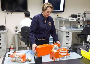 Investigator Erin Gormley prepares to access data from flight recorders in the NTSB's lab.