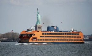 The ferry Andrew J. Barberi passing in front of the Statue of Liberty