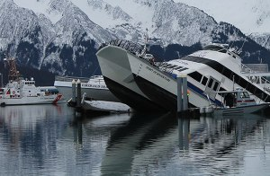 The stern of the 85 foot catamaran Spirit of Adventure rests on the bottom of Seward Small Boat Harbor.  Photo credit: Steve Fink