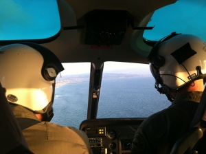 picture of helicopter pilot and co-pilot in flight.