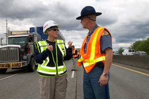 Kelly Nantel talks with local law enforcement on-scene at an NTSB investigation