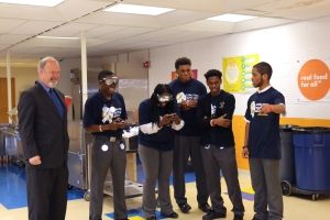 Rob Molloy with students at the National College Prep School