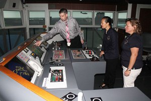 Vice Chairman Dinh-Zarr and Office of Marine Safety Director Tracy Murrell at the MITAGS Simulator.