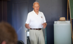 NTSB Administrative Law Judge Patrick G. Geraghty giving a presentation during AirVenture 2012.