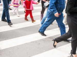 pedestrians in a crosswalk on summer day