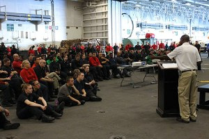 Nicholas Worrell speaks to sailors on board the USS George Washington