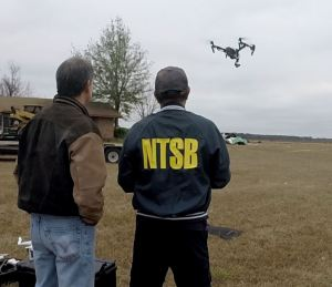 NTSB in vestigators using a UAS to inspect an inflight breakup