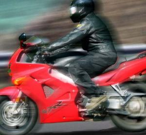 Side view of a motorcycle rider wearing protective gear