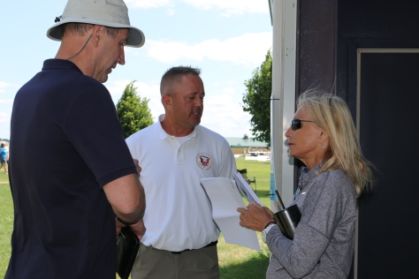 Mike Folkerts and Aaron Sauer talk with guest speaker and acrobatic pilot Patty Wagstaff